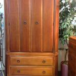 Thomasville armoire in the mission style with four drawers and shelf space.