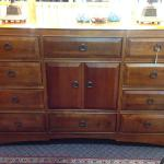Thomasville dresser in the mission style with 12 drawers (center cabinet opens to two drawers).