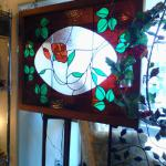 Large stained glass rose window. $245.00